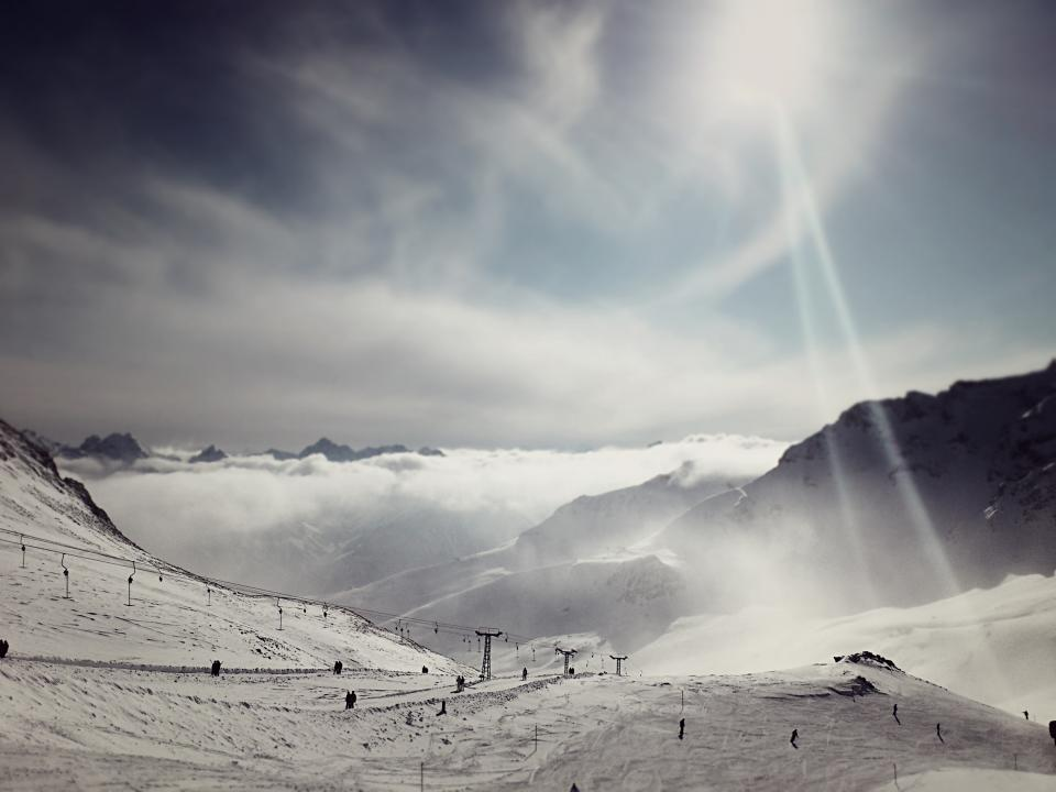 winter sports snowboarding snow slopes sky skiing runs mountains hills clouds chairlift