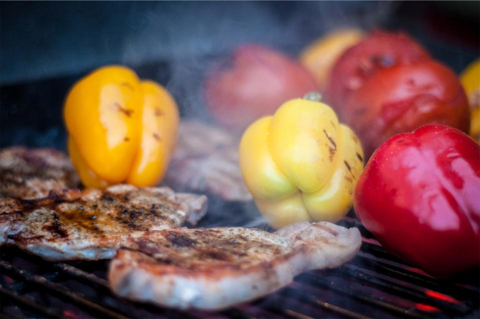 yellow smoke red porkchops peppers orange meat lunch grill food dinner cookout bbq barbecue