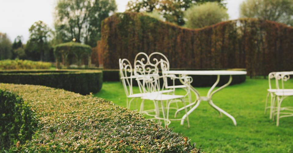 yard tables shrubs grass garden chairs