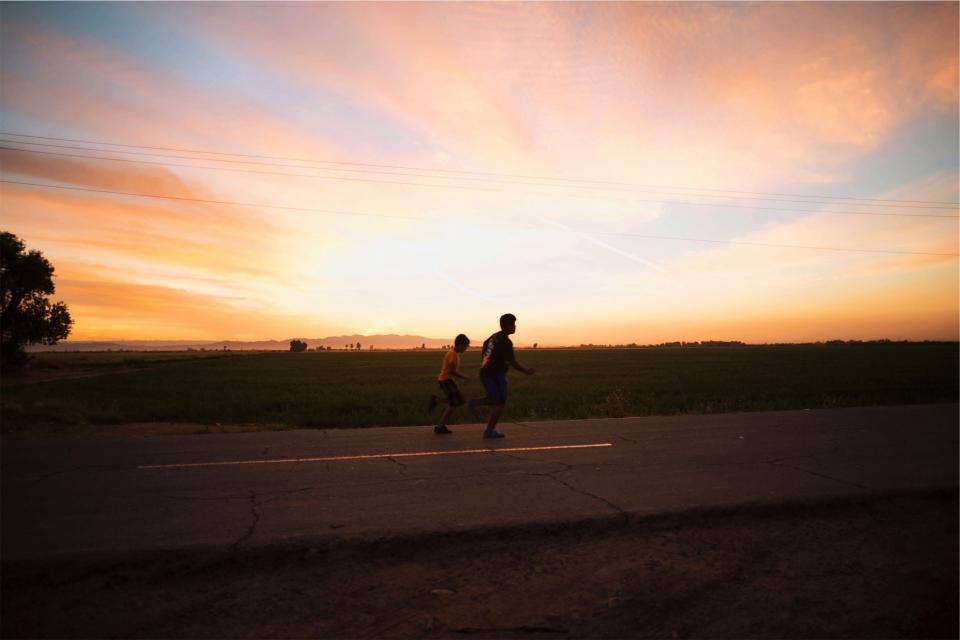 young sunset sky running road people pavement kids fitness exercise dusk children