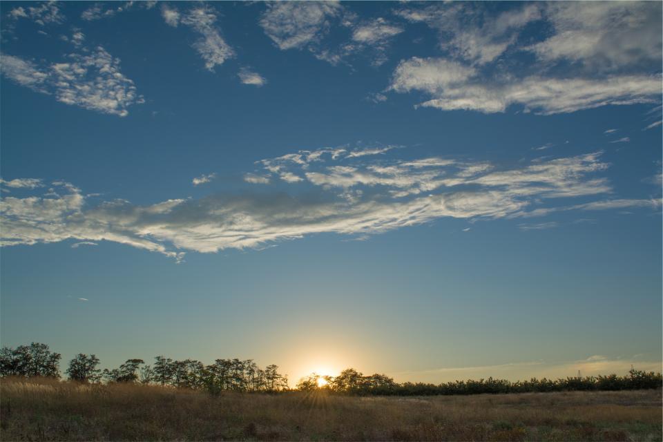 sunset sky rural grass fields country clouds blue