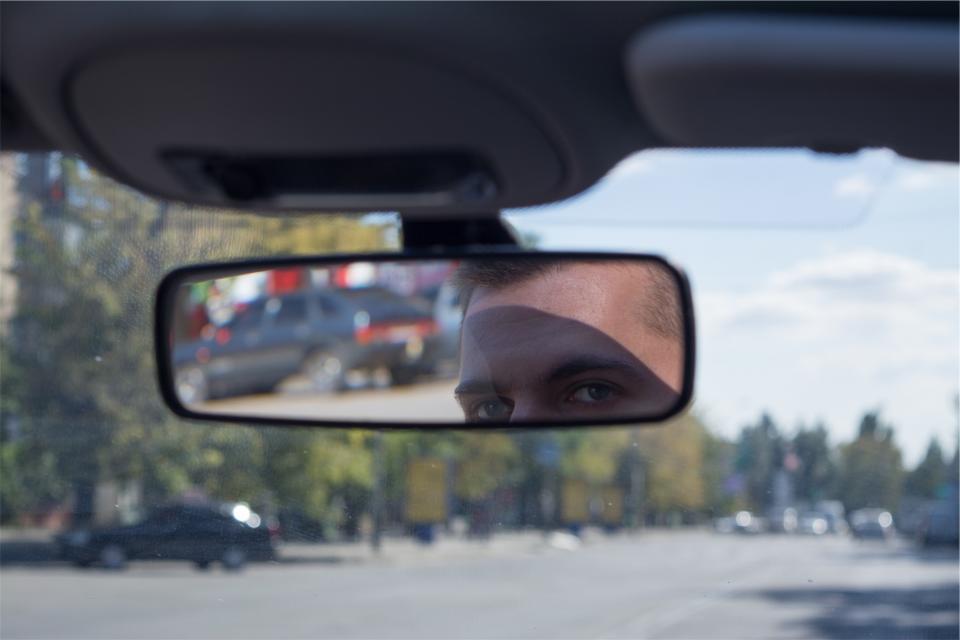 windshield road rearviewmirror man guy eyes driving car