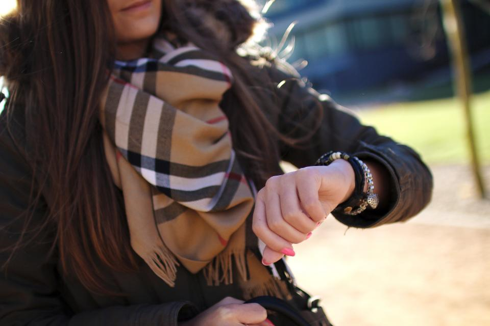 young woman watch time scarf people jacket hand girl fashion cold burberry brunette bracelet