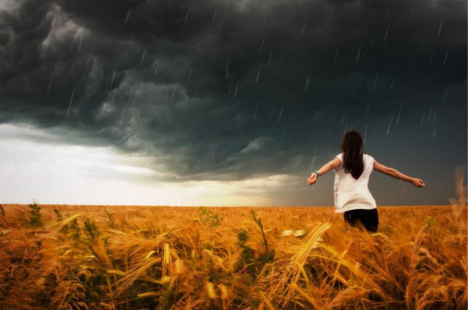 woman storm sky raining rain plants people grey girl fields drops cloudy