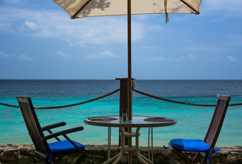 umbrella tropical table sky sea sand patio paradise ocean chairs beach