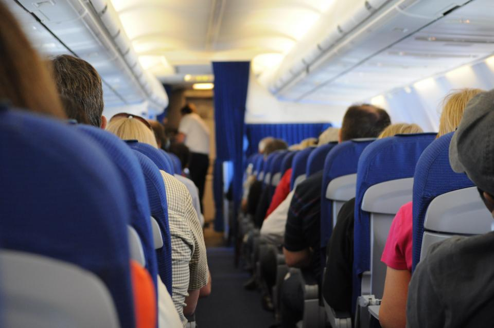 travel transportation seats people onboard aisle airplane