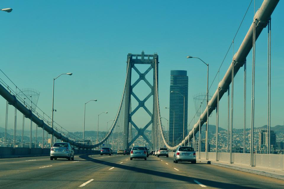 urban towers suvs road city cars buildings Bridge architecture