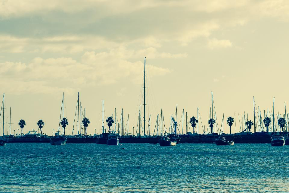 water sky sails sailboats harbour harbor docks clouds boats
