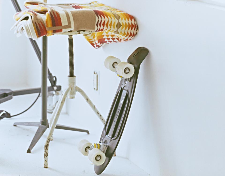 white wheels wall skateboard rug longboard chair carpet