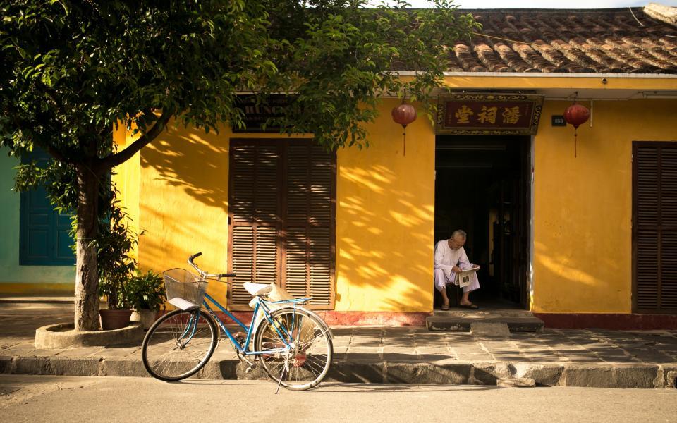 yellow tree street stones sidewalk roof oldman house bike bicycle Asian
