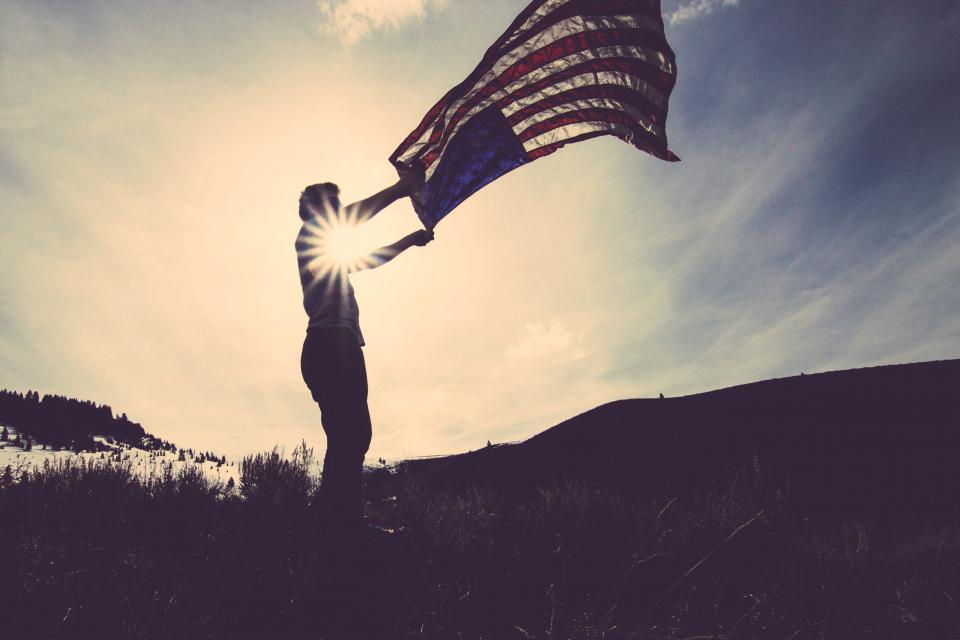 waving USA UnitedStates sunset sky shadow man guy flag dusk dark american