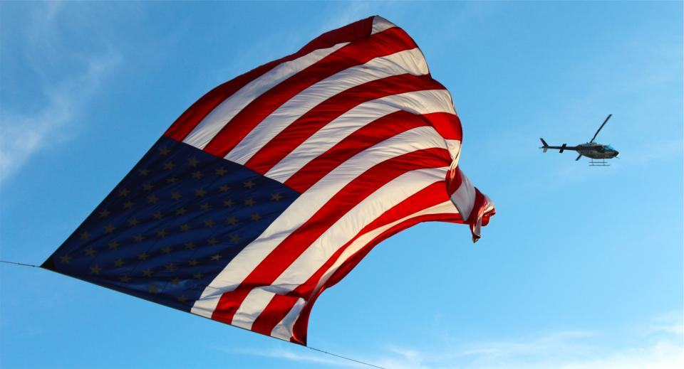 USA UnitedStates sky helicopter flying flag blue american air