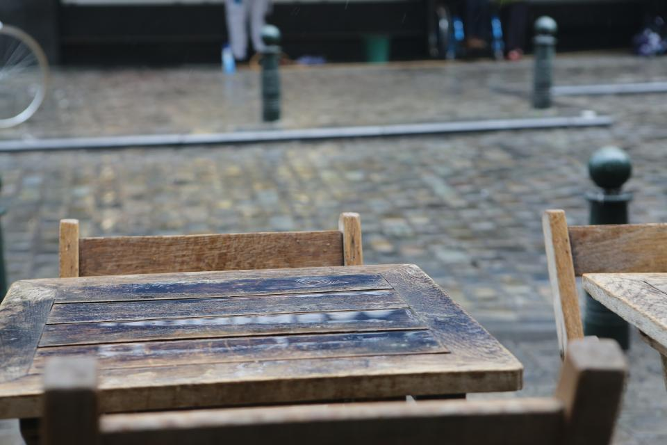 wood tables posts cobblestone chairs