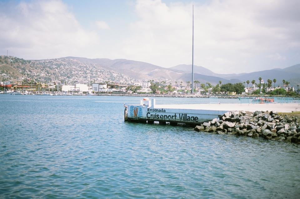 yachts water village sails port palmtrees mountains mexico ensenada docks city boats