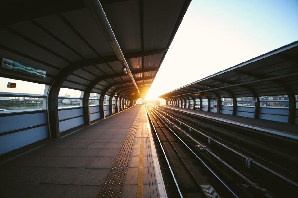 Windows travel transport tracks sunrays sunlight subway sky signs cover architecture