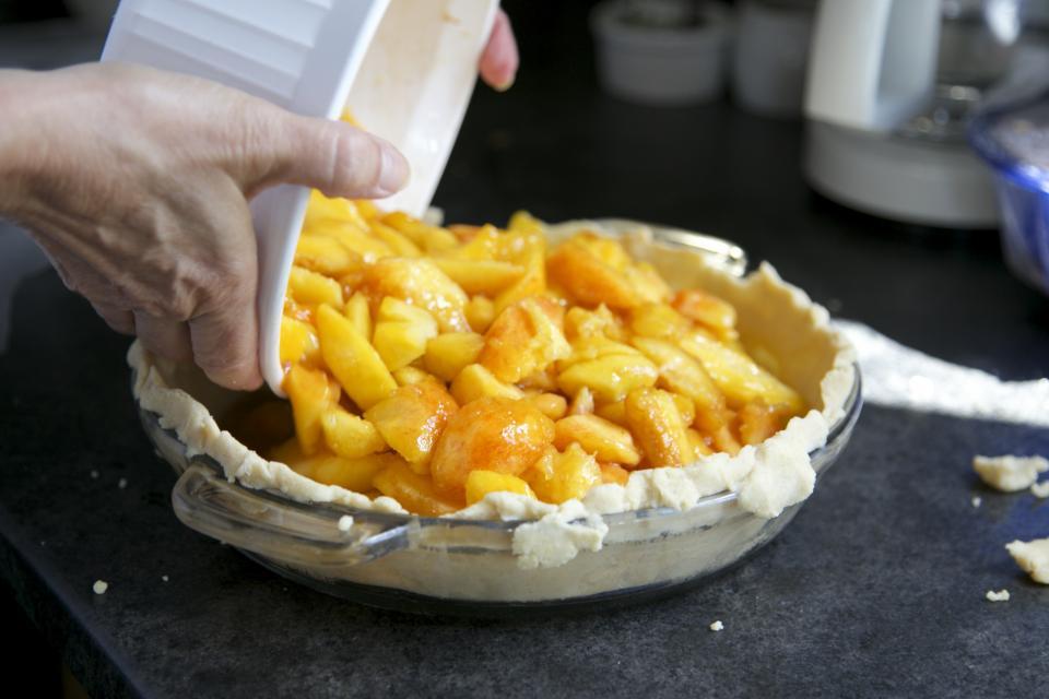 pie kitchen hands fruit dish dessert crust counter baking apples