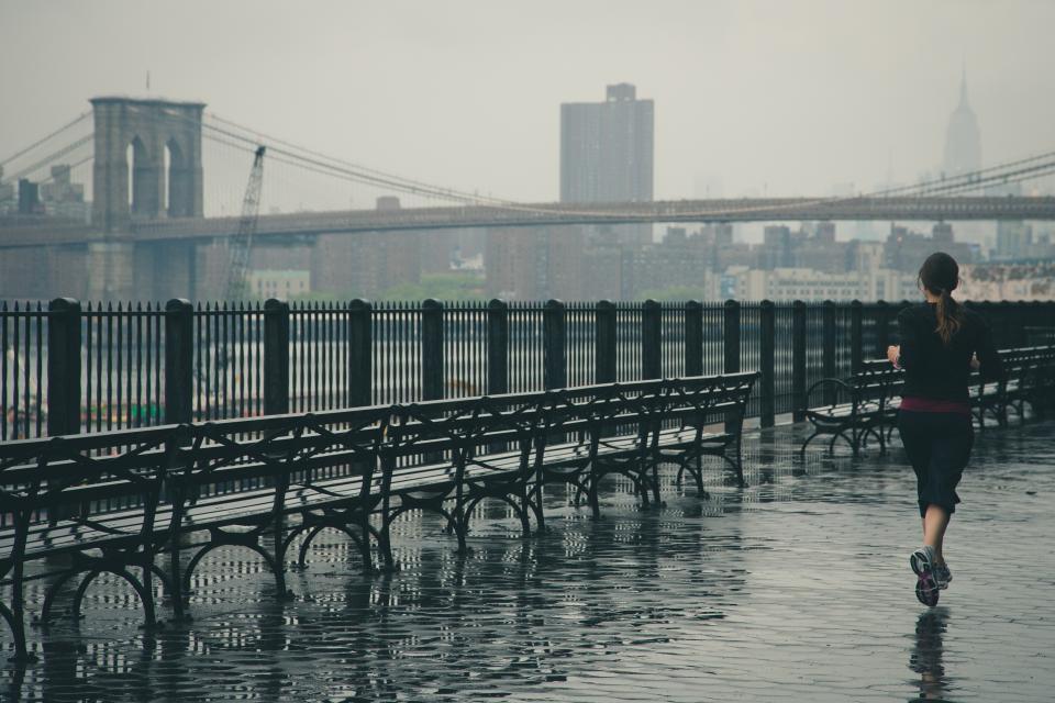 woman wet sports running runner raining rain railings jogging girl fitness fit city Bridge benches architecture active