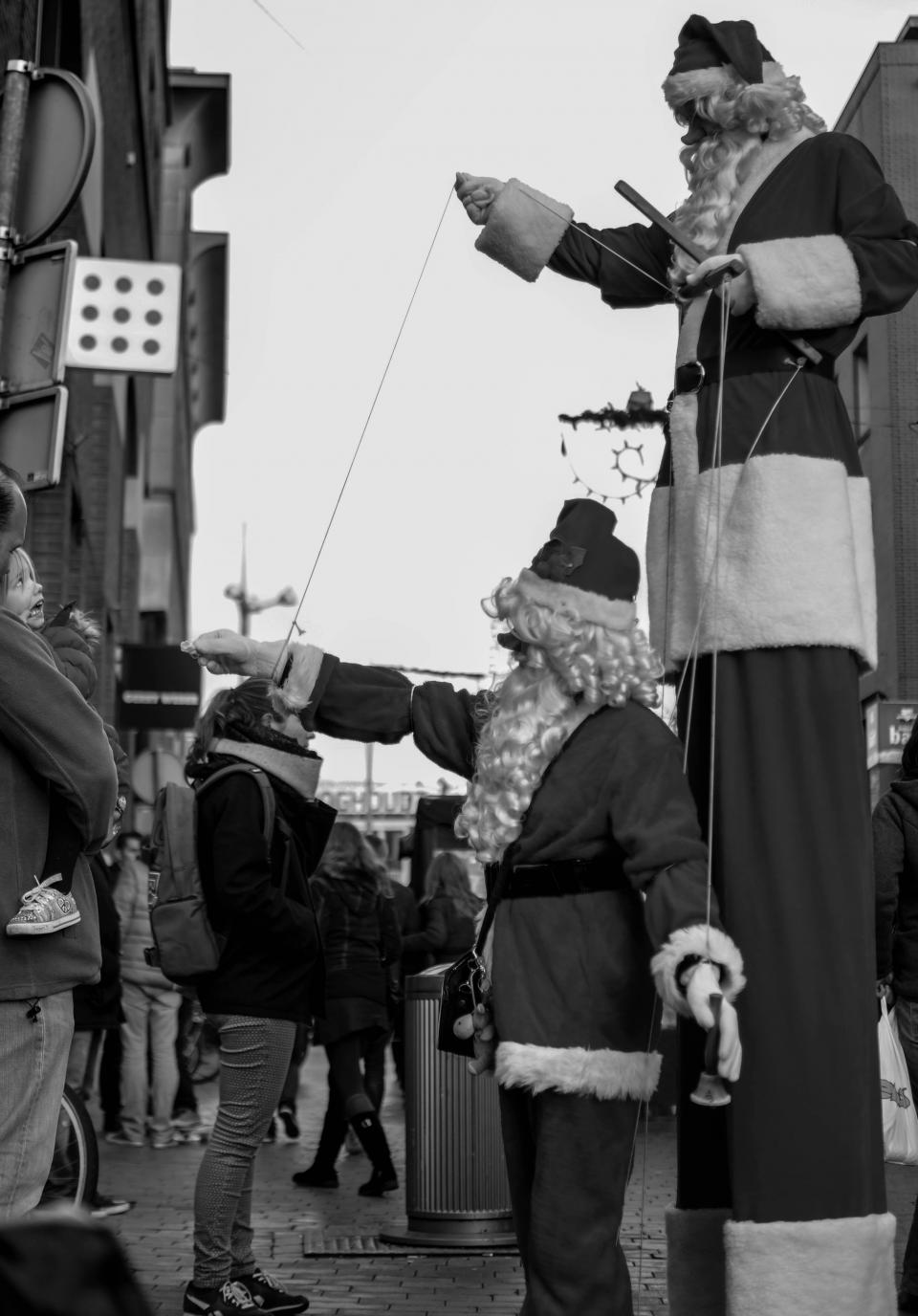 street stilts spectators santas people parade marionettes festival crowd christmas