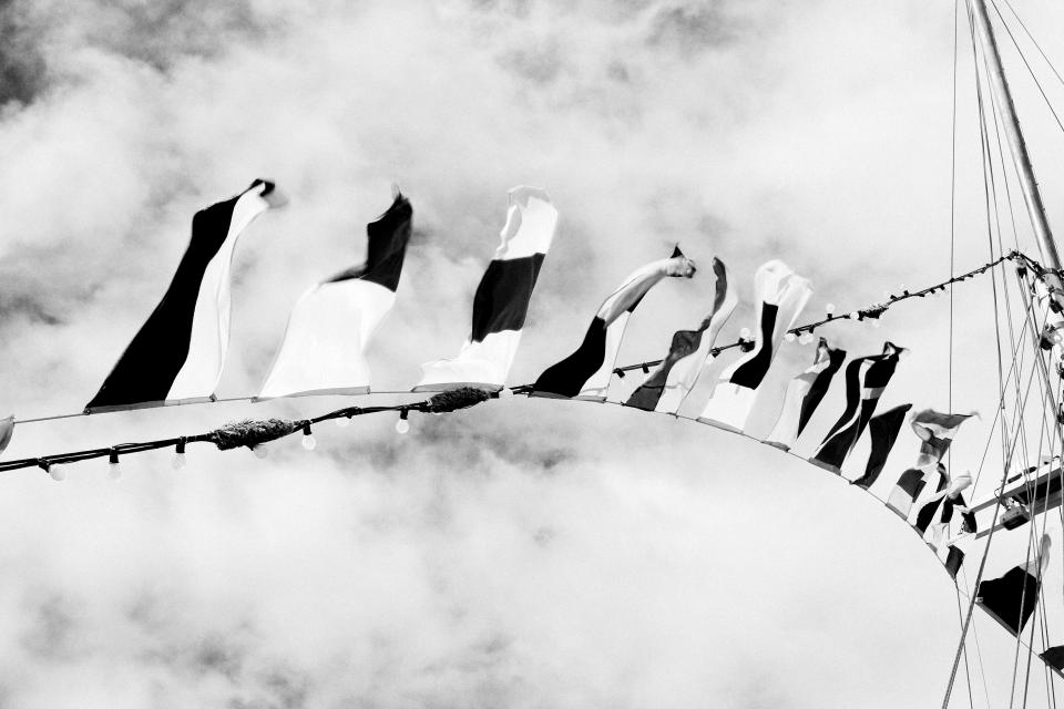 string sky sailboat ropes flags fairylights clouds blackandwhite
