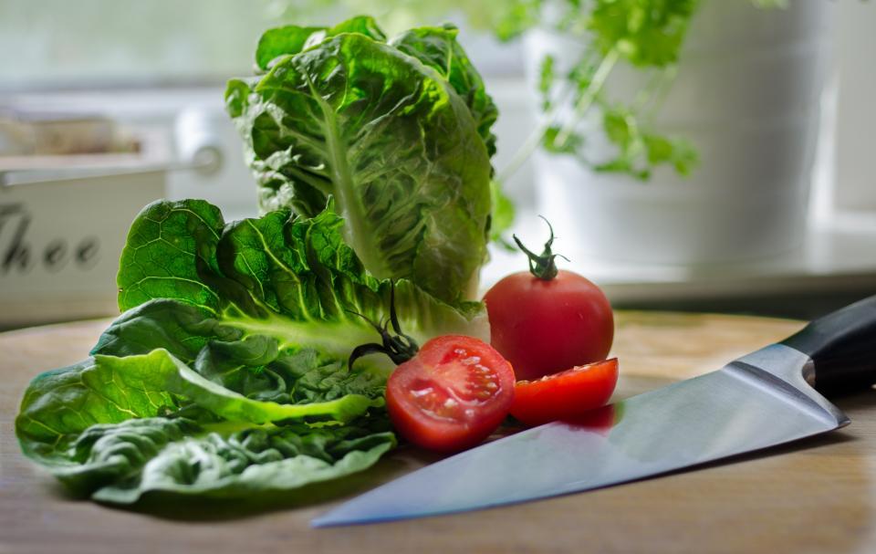 vegetables tomatoes salad lettuce knife kitchen Healthy food cuttingboard