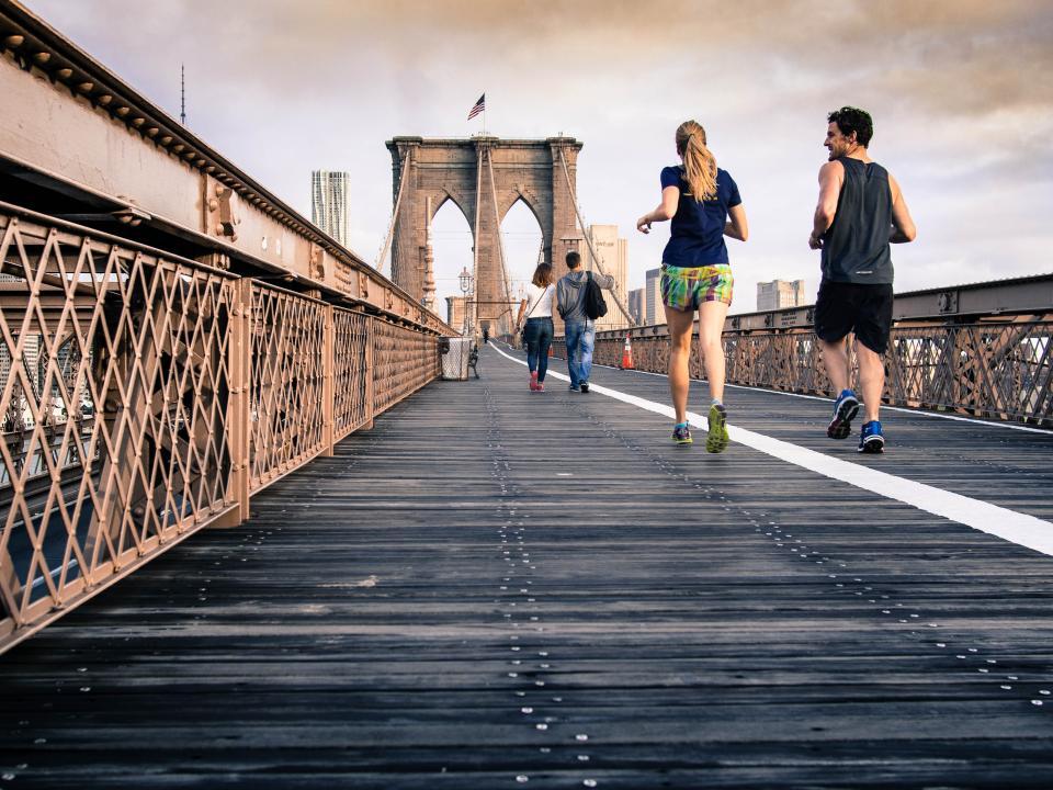 woman running people man jogging guy girl fitness exercise Brooklybridge architecture