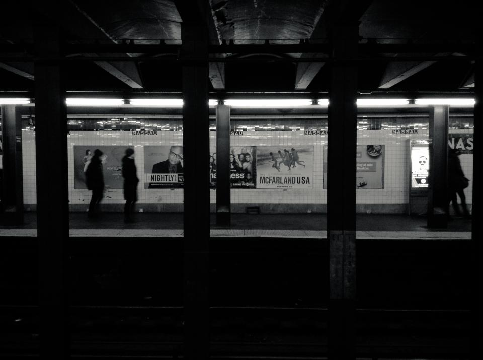 urban transportation subway station platform pillars people NYC NewYorkcity blackandwhite