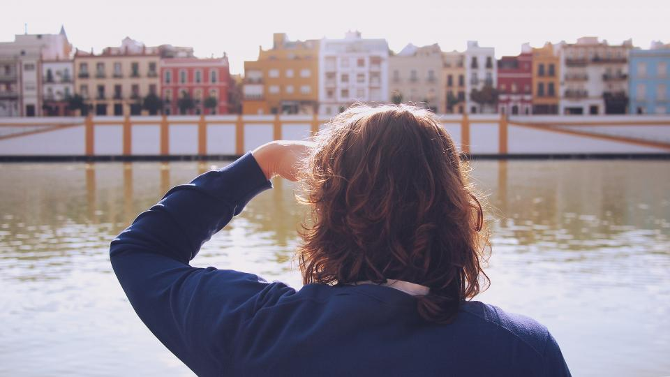 water town tourist Spain Seville river people looking city