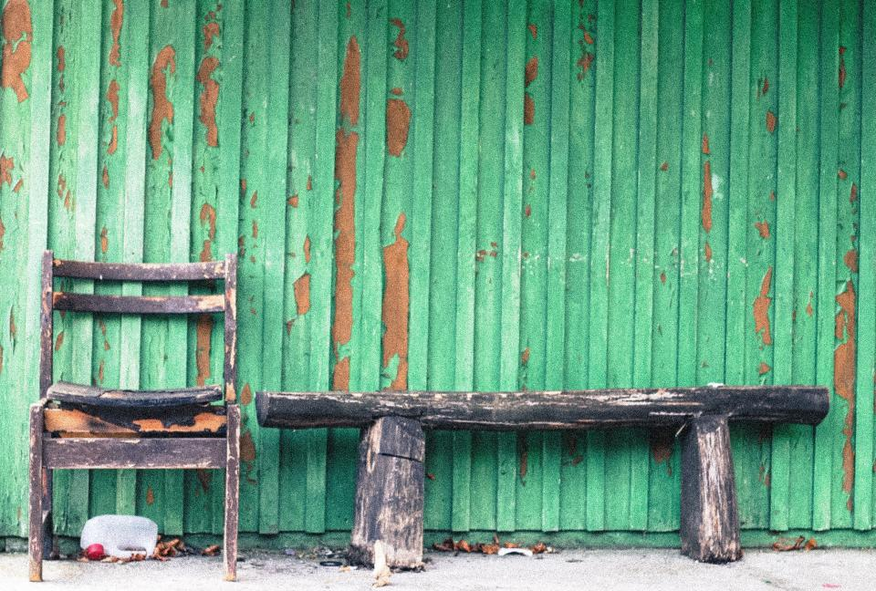 wood siding rust old green decay Damaged chipped chair bench