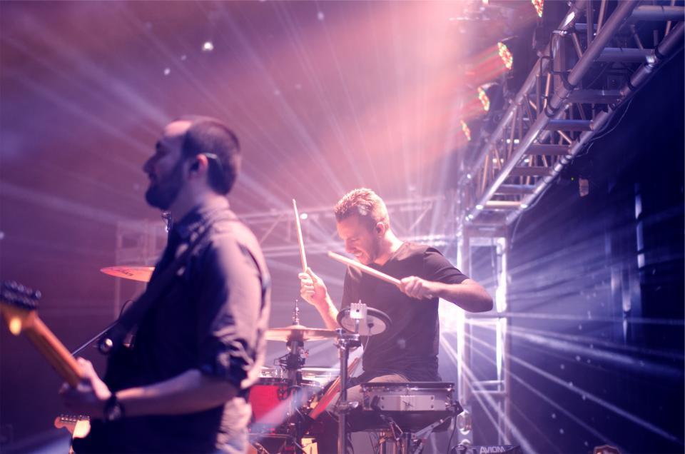 stage show musicians music lights instruments guitar entertainment drummer concert band