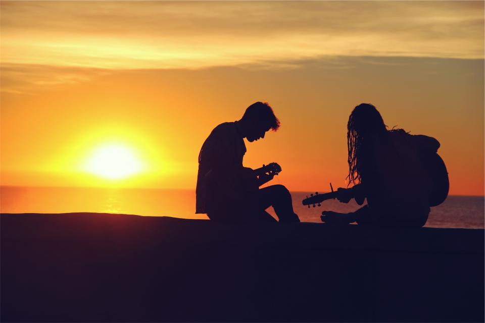 sunset silhouette people musicians music instruments guy guitars girl dusk