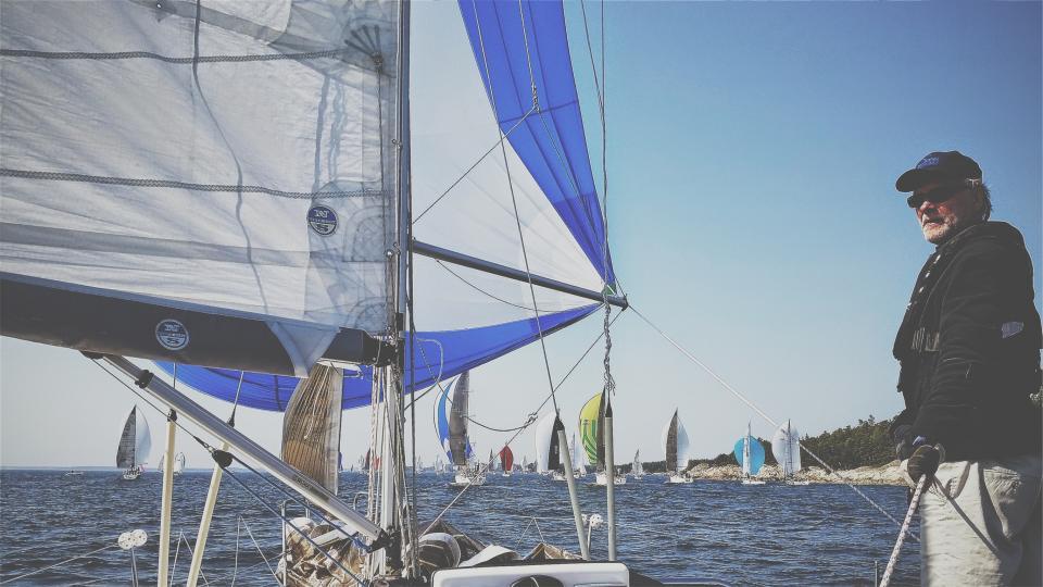 water sunshine sky sea sails sailing sailboats ocean blue