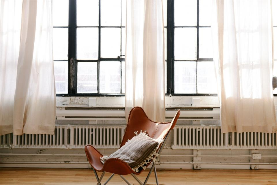Windows radiators pillow hardwood curtains chair